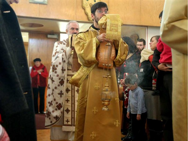 Deacon Michael La Libertie leads Father Maxym Lysack on a procession through the congregation during the service. Christ the Saviour Orthodox Church. JULIE OLIVER / OTTAWA CITIZEN