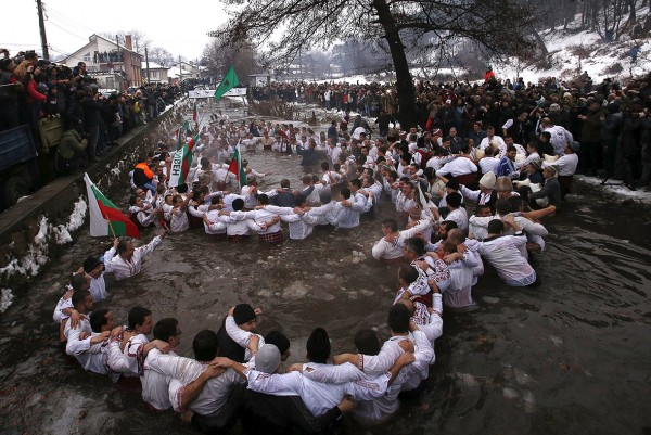 Bulgarian men dance in the icy waters of the Tundzha river during a celebration for Epiphany Day in the town of Kalofer Stoyan Nenov/Reuters