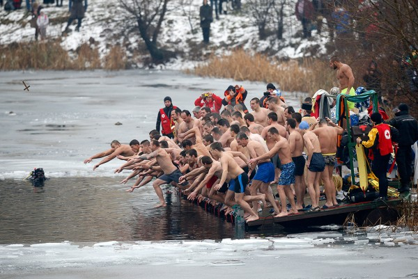 Men jump into the waters of a partly frozen lake in an attempt to grab a wooden cross on Epiphany Day in Sofia, BulgariaStoyan Nenov/Reuters