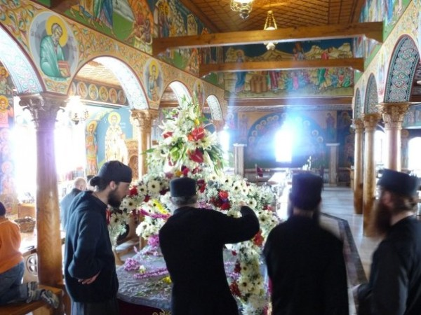 Monks decorating the tomb on Holy Friday in the monastery's dining hall