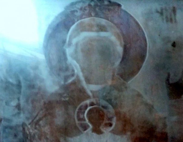 Image of the Holy Theotokos appears on the glass of an icon at a church in Russia