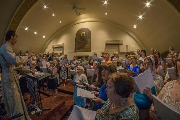 Dn Gregory Ealy, host choir director of St. Mary's Cathedral led the main choir during the all-night vigil on Saturday