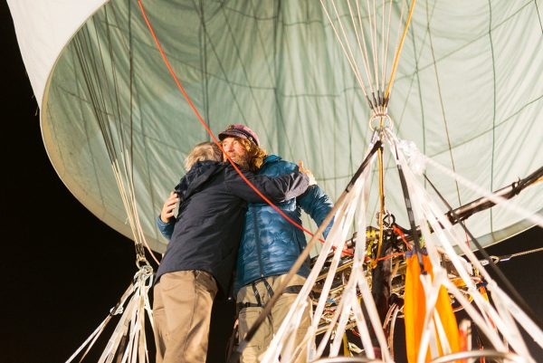 Russian adventurer Fedor Konyukhov hugs a member of his support staff before lift off (Oscar Konyukhov/ Reuters)