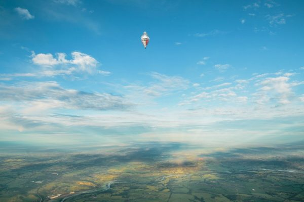 The balloon of Russian adventurer Fedor Konyukhov appears in the distance (Oscar Konyukhov/ Reuters)