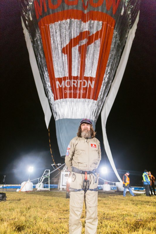 Russian adventurer Fedor Konyukhov stands in front of  his balloon while it is inflated  in Northam, Australia (Oscar Konyukhov/ Reuters)