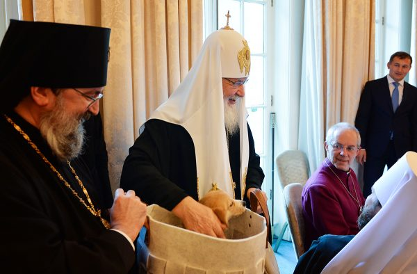 Parishioners of the Russian cathedral in London present a puppy to Patriarch Kirill