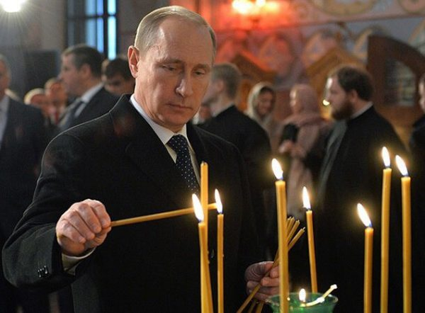 Putin says most likely he was baptized by Patriarch Kirill's father