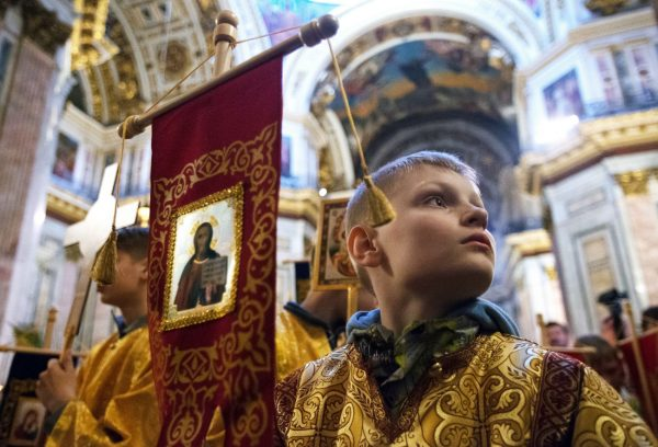 Photo: A boy during a Divine Liturgy for children at St. Isaac's Cathedral//Igor Russak. Ria Novosti