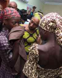 Oludolapo Osinbajo, wife of Nigerian Vice President Yemi Osinbajo, consoles one of the 21 released Chibok girls Oct. 13 in Abuja. (Credit: CNS photo/EPA.)