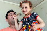 Iraqi Christian girl freed from Islamic State says 'mum, dad' again