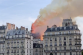 Unsure Flames Can Be Stopped, Bystanders Sing 'Ave Maria' as Notre Dame Cathedral Burns