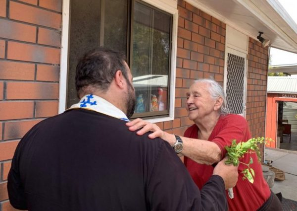 Greek Australian Priest Travels Amidst the Catastrophic Fires to Offer Help to Those in Need