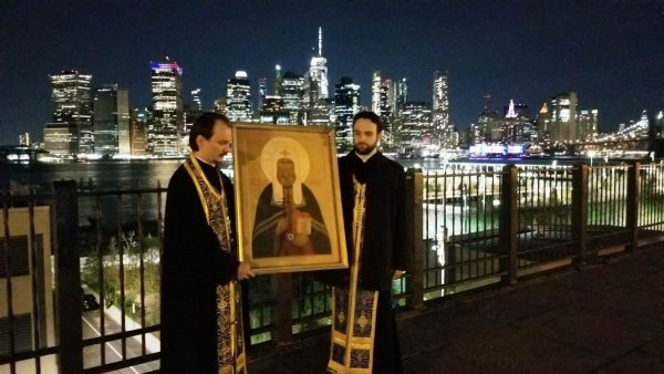 Clergy Drive through New York in Car Procession with the Cross