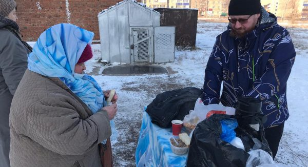 Priest Feeds the Homeless in Ishimbay