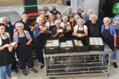 Volunteers from St George Greek Orthodox Church in Rose Bay gather to cook for the homeless